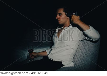 A Young Man In Casual Business Clothes Sitting Alone In Dark Bedroom Holding A Pistol Aim At His Hea