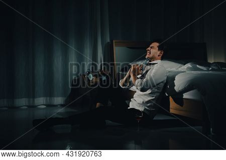 A Young Man In Casual Business Clothes Holding A Pistol Close Eyes And Aim At His Chin To Kill Himse