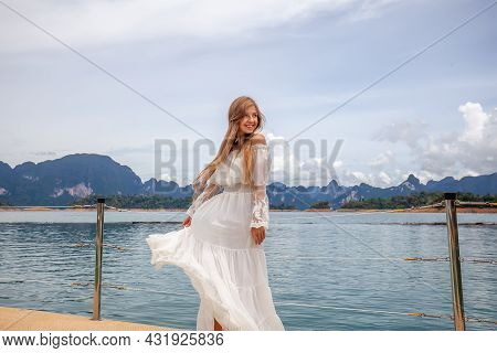 Happy Travel Girl Fun On Wooden Pier With Lake, Rainforest Jungle And Mountains On Background. Femal