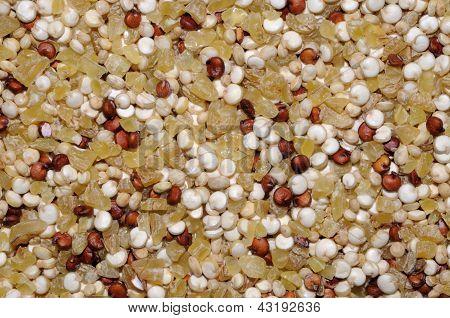Dried quinoa seeds and bulgar wheat.