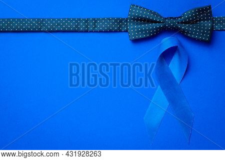 Cancer Awareness Blue. Blue Ribbon, Fashion Bowtie Isolated On Deep Blue Background. Awareness Prost