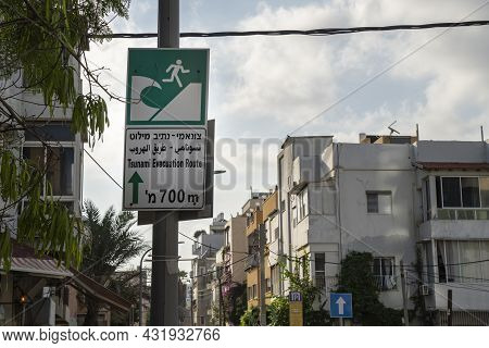 Tel Aviv, Israel - August 16th, 2021: A Multilingual Sign Directing To A Tsunami Evacuation Route, I