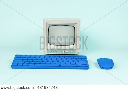 Retro Monitor And Blue Keyboard With Mouse On A Light Background. Retro Equipment.