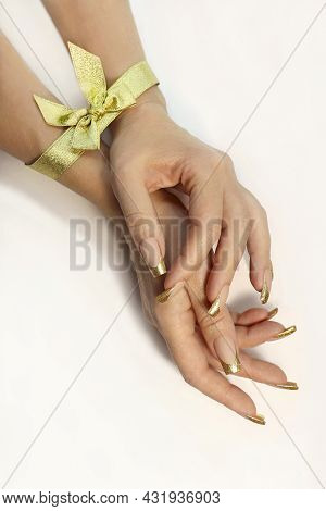 Golden Classic French Manicure With A Bow On The Hand.