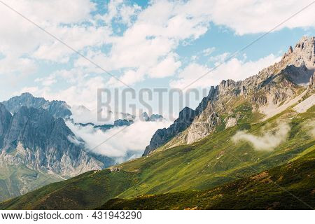 Big Mountains In Picos De Europa Landscape With White Clouds