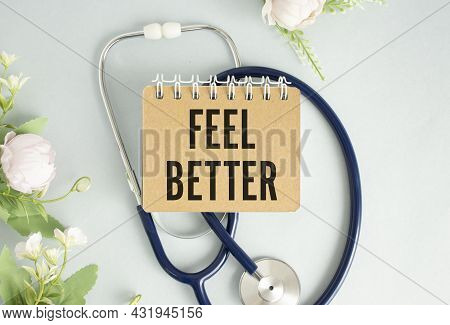 Text Feel Better On The White Card With The Stethoscope. Medical Concept Photo
