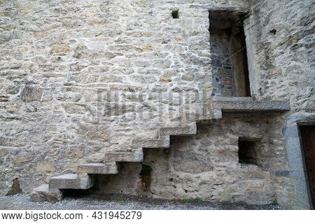 Steps Leading Upwards On Side Of Wall Of Stone Castle To Opening, Ross Castle, Ireland.