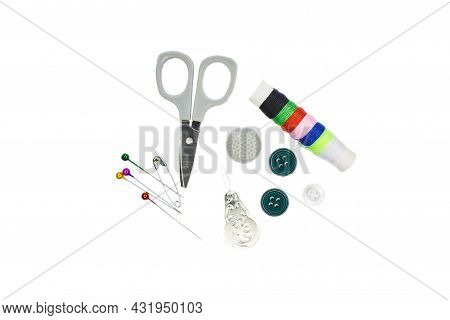 Sewing Needle Thread Scissors Thimble Tailor Buttons. Closeup Top View Of Sewing Tools Accessories O