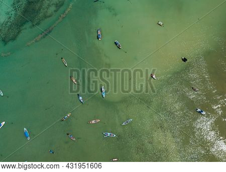 Aerial Drone Bird's Eye View Photo Top Down Of Tropical Sea With Long Tail Fishing Boats Travel Boat
