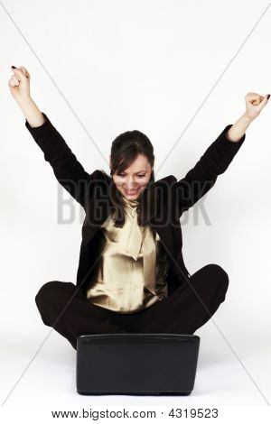 Young Woman Happy In Front Of Her Computer