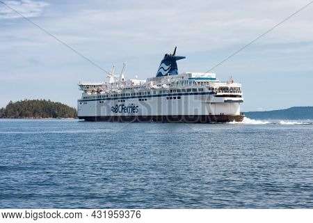 Victoria, Vancouver Island, British Columbia, Canada - August 18, 2021: Bc Ferries Boat Leaving The