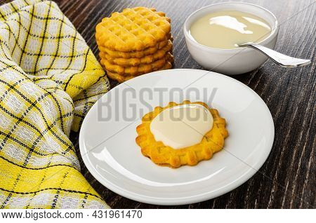 Checkered Napkin, Stack Of Waffle Cookies, Teaspoon In Bowl With Condensed Milk,cookie Poured Conden