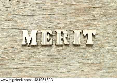 Alphabet Letter In Word Merit On Wood Background