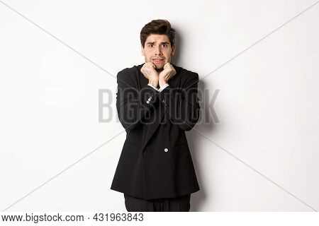 Image Of Scared And Insecure Young Businessman In Suit, Trembling From Fear And Looking Horrified, S