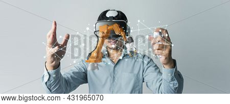 Asian Man Engineer Wearing Vr Headset Design Arm Robotic Industrial Project On Banner. Innovation Fu