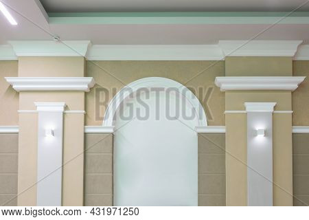 Detail Of Corner Ceiling With Intricate Crown Molding On Column With Spot Light.