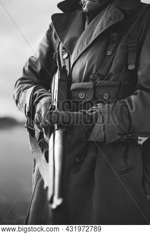 Soldier Of Usa Infantry Of World War Ii Holds Submachine Weapon In Hands. Black And White Photograph