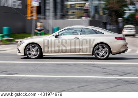 Mercedes-benz E-class Coupe C238 Car In Motion On The Street. Side View Of Fast Driving Premium Merc