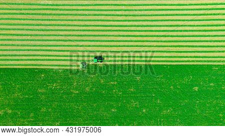 Above Top View On Tractor As Pulling Grass Cutting Machinery Over Field Of Clover, Cutting Alfalfa I