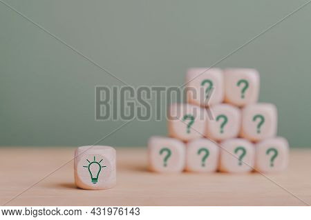 Green Light Bulb On Wooden Cube With Other Blurred Question Cubes For Good Idea, Best Selection, Bes