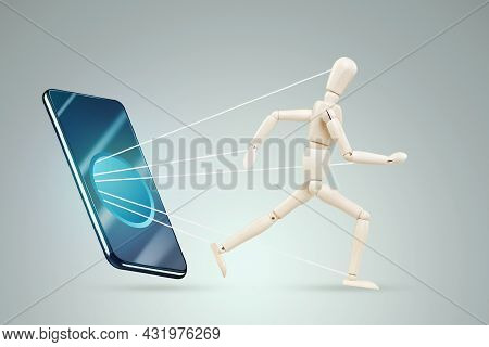 The Smartphone Is Sucking In A Figurine Of A Man Of A Puppet. The Concept Of Smartphone Addiction, M