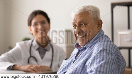 Happy Optimistic Senior Man Looking At Camera With Toothy Smile