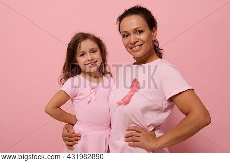 Isolated Portrait On Colored Background With Copy Space Of Mixed Race Woman Hugging Her Daughter, We