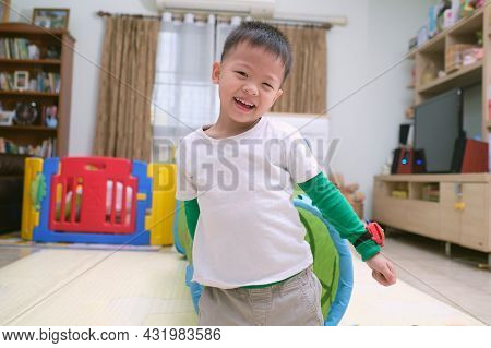 Cute Happy Smiling Asian Little Kindergarden 5 Year Old Boy Child Looking At Camera While Playing An