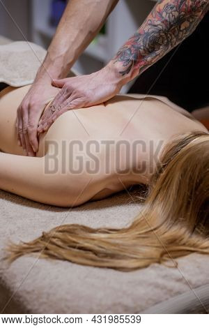 Masseur Doing Massage On Man Body In The Spa Salon. Beauty Treatment Concept