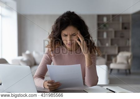 Unhappy Depressed Young Latin Woman Reading Letter With Bad News.