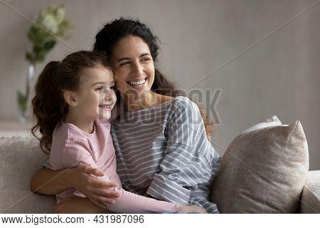 Dreamy Bonding Affectionate Family Visualizing Future Indoors.
