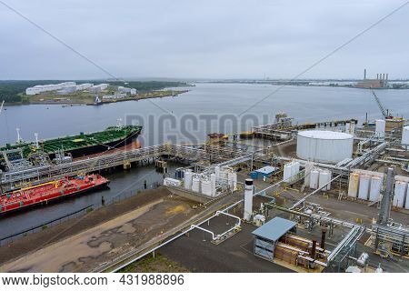 Aerial View Tanker Ship Unloading In Port Of Logistic Import Export Business With Rig Platforms, Oil
