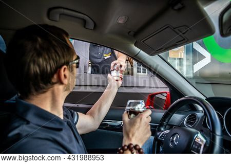 Prague, Czech Republic - 11.08.2021: Mcdonalds Restaurant, Baying Meal By Drive Thru From The Car In