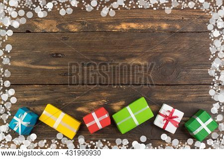 Gift Boxes And Colorful Present For Christmas On Wood Table. Top View With Copy Space.