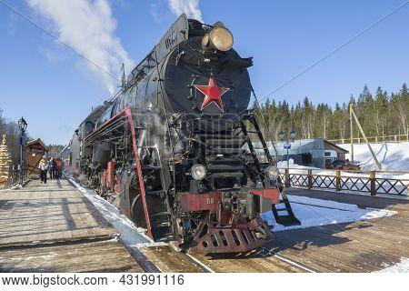 Ruskeala, Russia - March 10, 2021: Old Soviet Steam Locomotive Lv-0522 With Tourist Retro Train