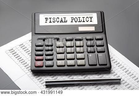 Fiscal Policy Word On The Calculator On Chart With Pen