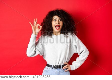 Excited Pretty Woman Say Yes, Showing Okay Gesture And Looking Enthusiastic, Agree Or Like Something