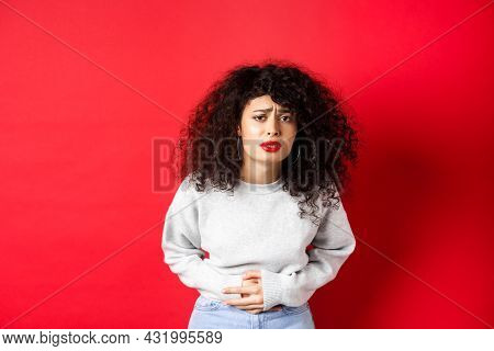 Image Of Young Woman Having Stomach Ache, Bending From Pain And Complaining On Painful Menstrual Cra