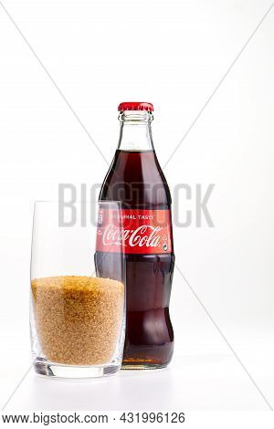 Tallinn, Estonia - 12.02.21 . A Bottle Of Coca Cola Soft Drinks. Bottle Of Cocacola And Glass With B
