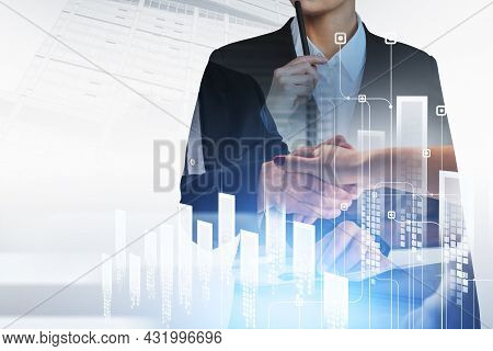 Businessman Wearing Formal Suit Is Shaking Hands With Businesswoman. Office Workplace And City Skysc