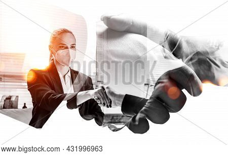 Businessman Wearing Formal Suit Is Shaking Hands With Businesswoman In Mask. Office Workplace In The