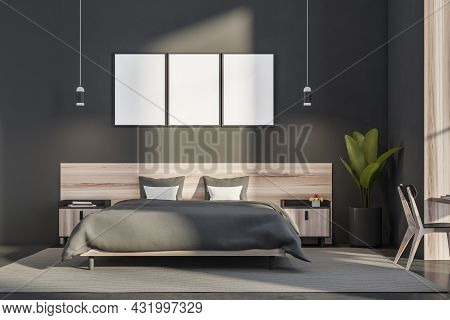 Bedroom Interior With Three Empty Canvas, Two Pendant Lights, A Chair, A Rug, A Wooden Bed With Beds