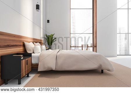White Bedroom Interior With A Desk In The One Of The Niche Windows, A Wood Bed Headbord With A Bedsi