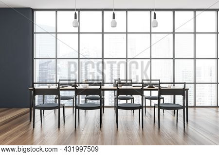 Dining Room Interior With A Panoramic View, Three Pendant Lights, A Table With Eight Chairs, A Woode