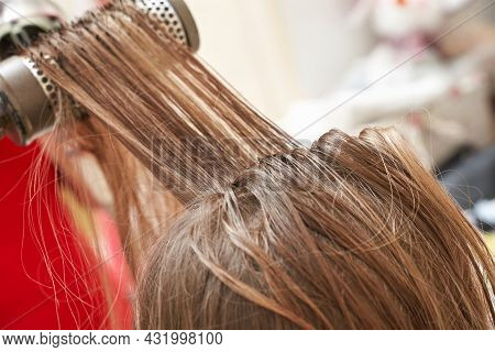 Mother Dry Daughter Long Hair. Home Activity. New Normal. Barber Equipment. Lifestyle Kid Hairdress.