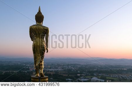 Big Golden Buddha Statue Standing In Wat Phra That Kao Noi On Morning At Nan Province Thailand,