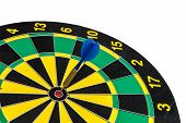 Blue darts on the target in red poster
