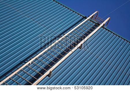 Metal Ladder On Blue Metal Wall