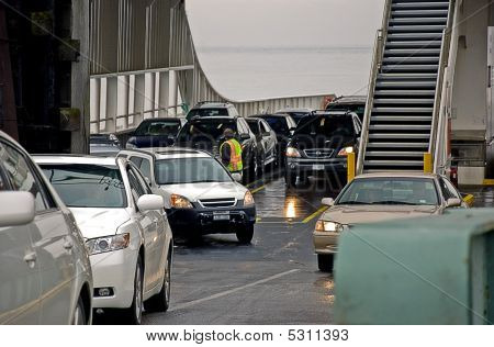 Cars Offloading From A Ferry Boat