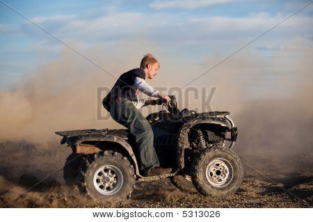 Teen Riding Atv Quad